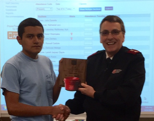 The Salvation Army of the Midlands, Corps Office, Maj. Roger Coulson presents a plaque of participation to A.C. Flora High School J.R.O.T.C. for their participation in the 2014 Battle of the Bells.
